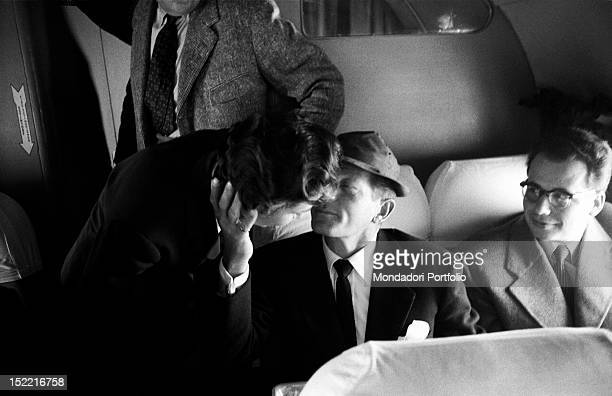 The US actor Danny Kaye photographed in an affective moment with a young hostess in the plane Italy 1956