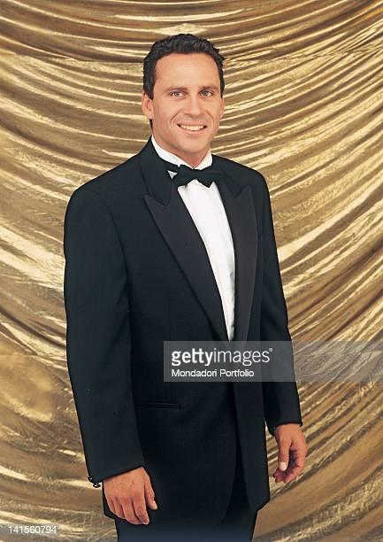 The US actor Ethan Wayne posing smiling and wearing an elegant tuxedo 1995