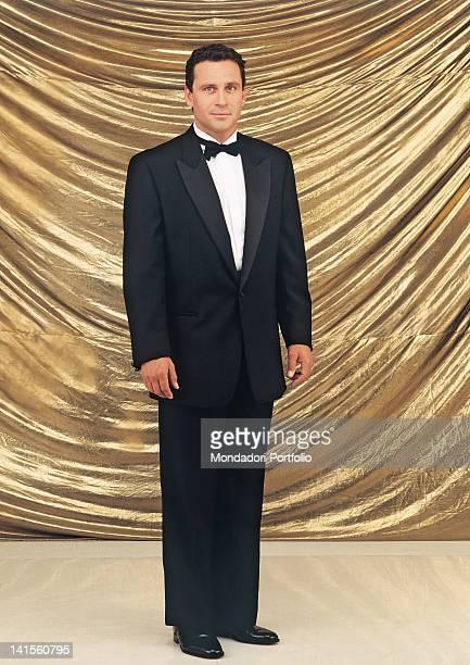 The US actor Ethan Wayne posing wearing an elegant tuxedo 1995