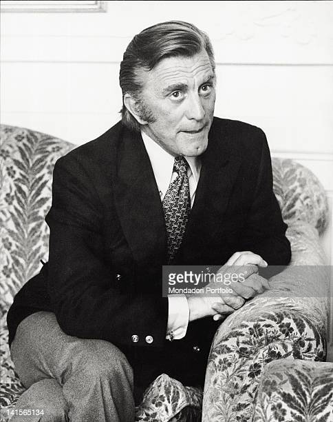 The US actor Kirk Douglas is sat on an armchair in a hotel in Italy during an interview Rome 1971