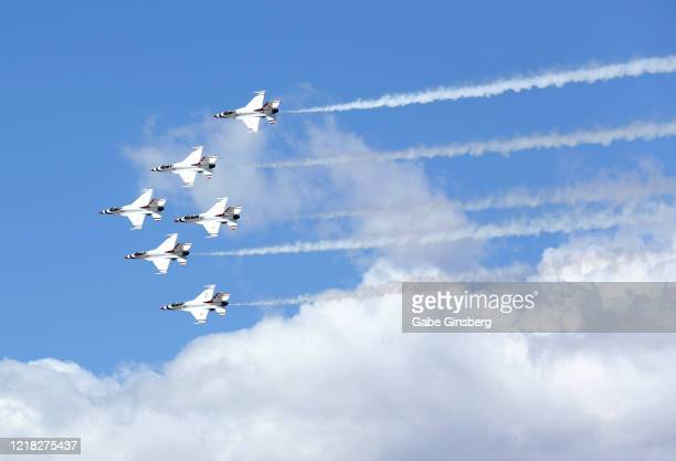The US Air Force Air Demonstration Squadron Thunderbirds perform a flyover in honor of frontline responders in the fight against the coronavirus on...