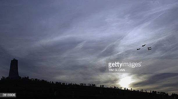 The US Air Force Thunderbirds close the day's air show doing the Missing Man formation over the main grounds of the the Wright Brothers Memorial on...