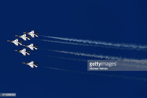 The US Air Force Thunderbirds consisting of six F16 aircraft perform a flyover over New York Harbor on May 22 2015 in New York City The flyover is...