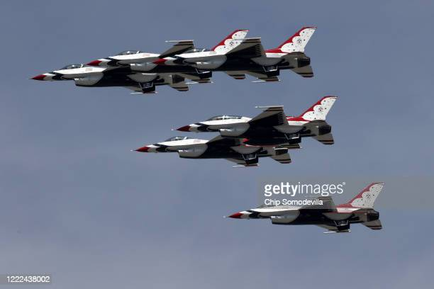 The US Air Force Thunderbirds fly across the nation's capital during a tribute to healthcare workers first responders members of the military and...