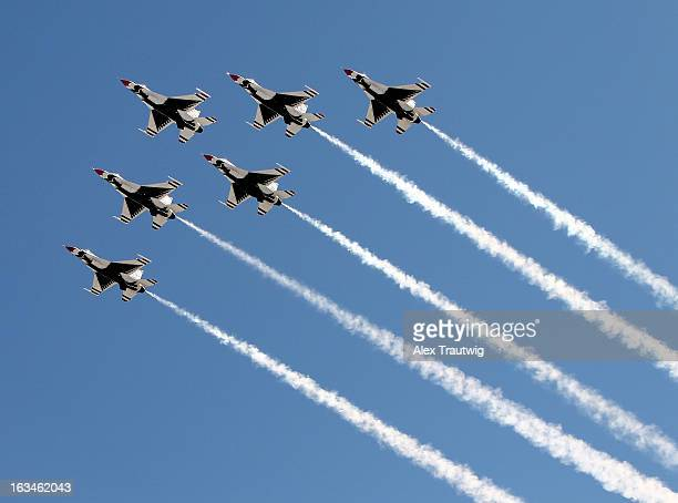 The US Air Force Thunderbirds fly over during prerace ceremonies for the NASCAR Sprint Cup Series Kobalt Tools 400 at Las Vegas Motor Speedway on...
