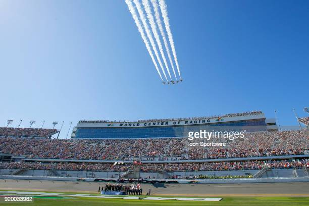 The US Air Force Thunderbirds fly over the track after the playing of the National Antehm prior to the 60th running of the Daytona 500 on February 18...