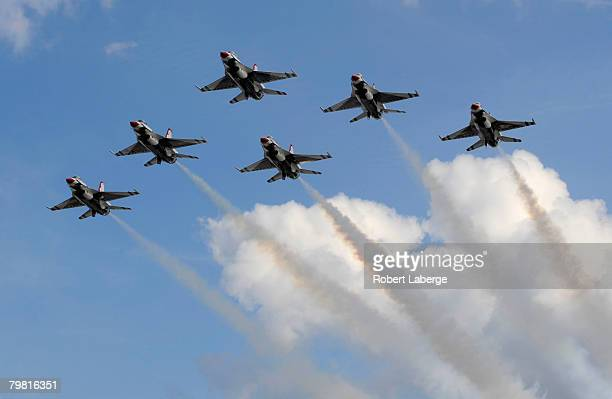 The US Air Force Thunderbirds fly overhead during prerace ceremonies for the NASCAR Sprint Cup Series Daytona 500 at Daytona International Speedway...