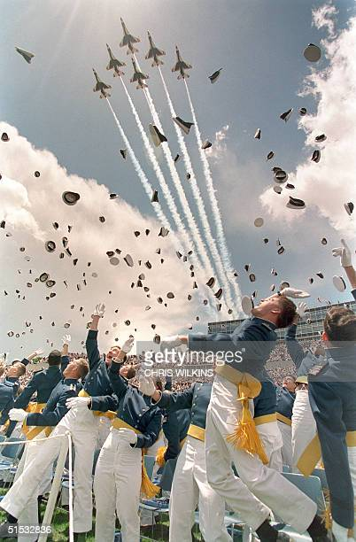 The US Air Forces Thunderbirds jetfighters perform a flyover as graduates of the class of 1995 of the US Air Force Academy in Colorado Springs CO...