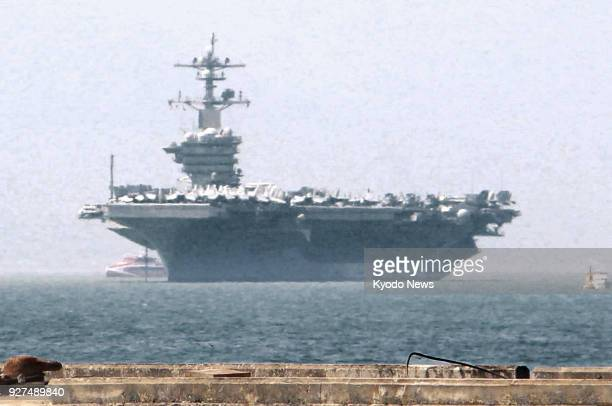 The US aircraft carrier Carl Vinson arrives in Danang Vietnam on March 5 becoming the first US carrier to visit Vietnam since the end of Vietnam War...