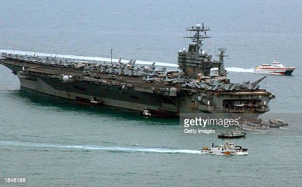 The U.S. Aircraft carrier USS Carl Vinson docks after arriving at the Pusan Port to participate in the joint U.S.-South Korea military exercise,...