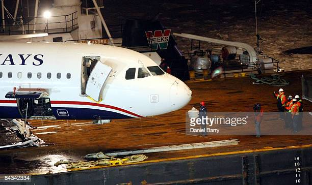 The US Airways Airbus A320 is placed on a barge in the Hudson River Saturday January 17 2009 in New York City US Airways Flight 1549 crashed shortly...