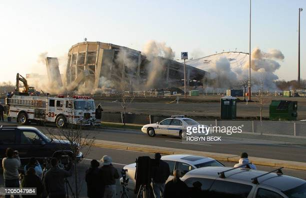The US Airways Arena in Landover Maryland begins to collapse as explosions are detonated to destroy it to make way for a shopping center 15 December...