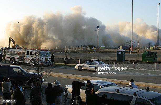 The US Airways Arena in Landover Maryland collapses as the building is destroyed to make way for a shopping center 15 December 2002 The venue which...