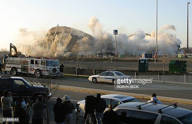 The US Airways Arena in Landover MD collapses as the building is destroyed to make way for a shopping center 15 December 2002 The venue which opened...