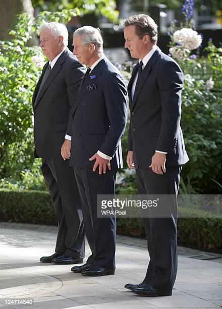 The US Ambassador Prince Charles Prince of Wales and Prime Minister David Cameron attend a memorial ceremony at the September 11 memorial garden in...