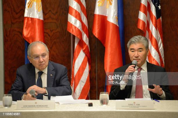 The US ambassador to the Philippines, Sung Kim , speaks as the Philippines ambassador to the US, Jose Manuel Romualdez , looks on during a joint...