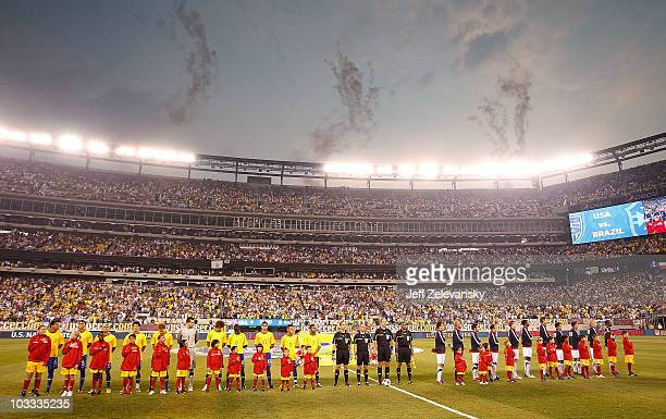 The US and Brazil stand on the field before a friendly match at the New Meadowlands on August 10 2010 in East Rutherford New Jersey