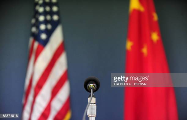 The US and China flags stand behind a microphone awaiting the arrival of US Senator John McCain who was joined by Senators Lindsey Graham Amy...