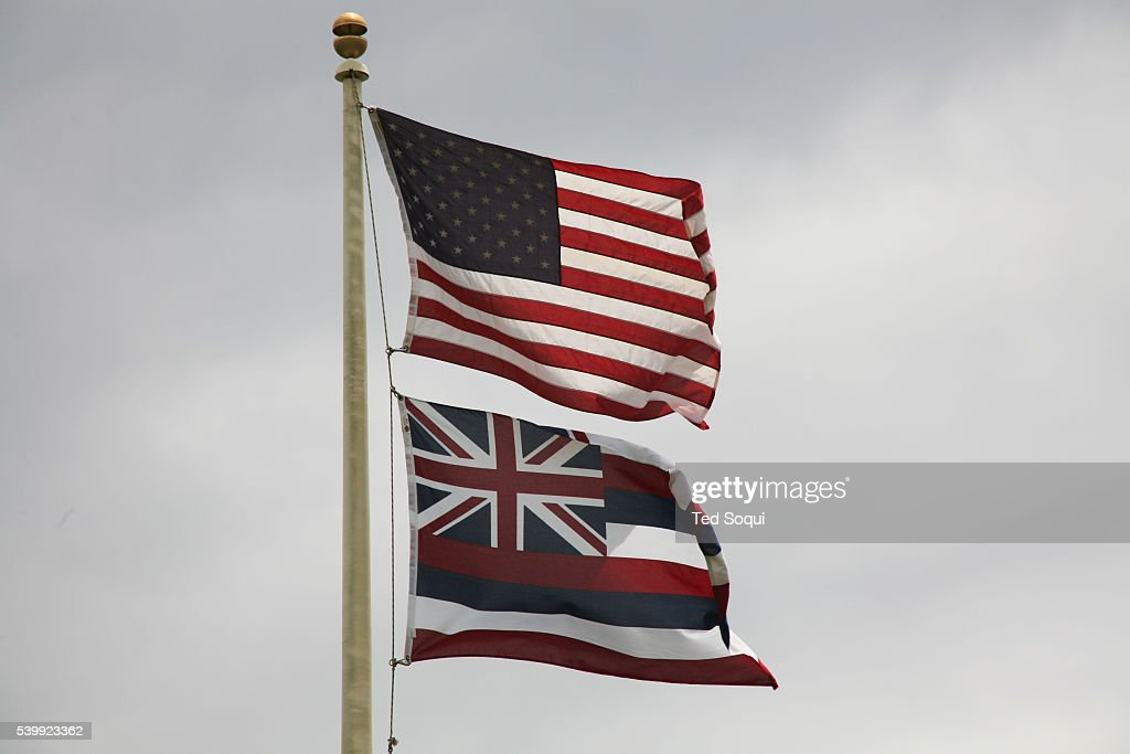 The US and Hawaiian flag flying near Hana, Maui  News Photo