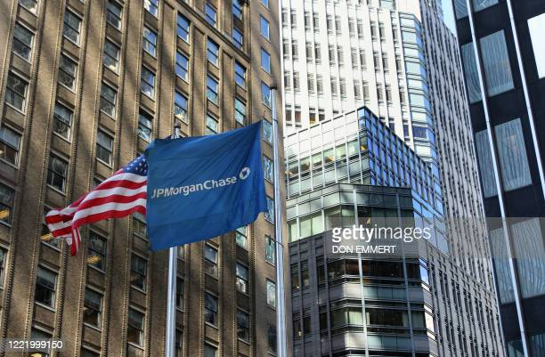 The US and JP Morgan Chase flags fly in front of the Bear Stearns headquarters and JP Morgan Chase headquarters in New York on March 17, 2008. JP...