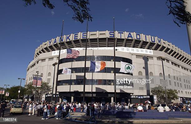 The US and New York Flags fly at halfmast outside Yankee Stadium on the one year anniversary of the tragic events of September 11 during the...