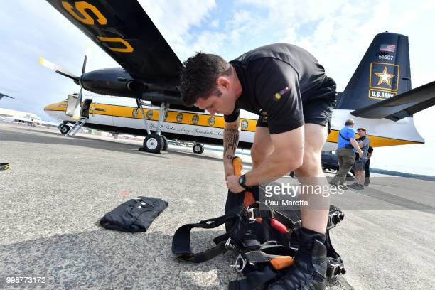 The US Army Parachute Team The Golden Knights prepare for their demonstration jump at 10500 feet at the 2018 Great New England Air and Space Show on...