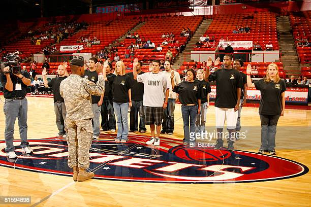 The US Army's newest recruits swear in before the game between the Atlanta Dream and the Houston Comets at Reliant Arena on June 16, 2008 in Houston,...