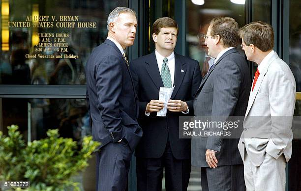 The US Attorney for Northern Virginia Paul McNulty and Federal Prosecutor Randy Bellows stand with unidentified fellow prosecuting attorneys shortly...