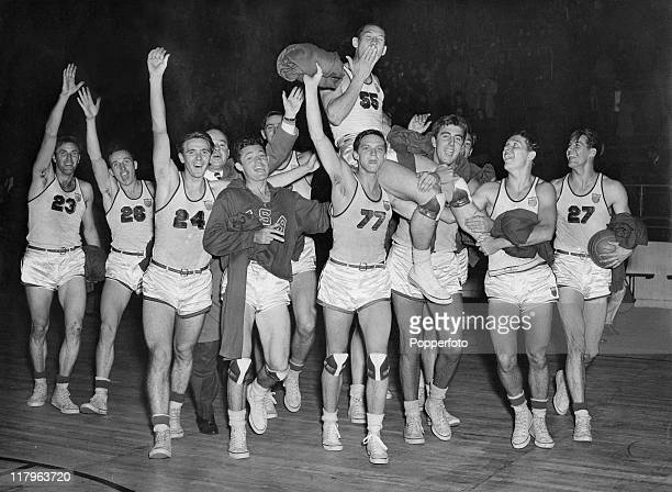 The US basketball team hold their captain Jesse Renick aloft after they beat France 6521 to win the final at Harringay Arena during the the London...
