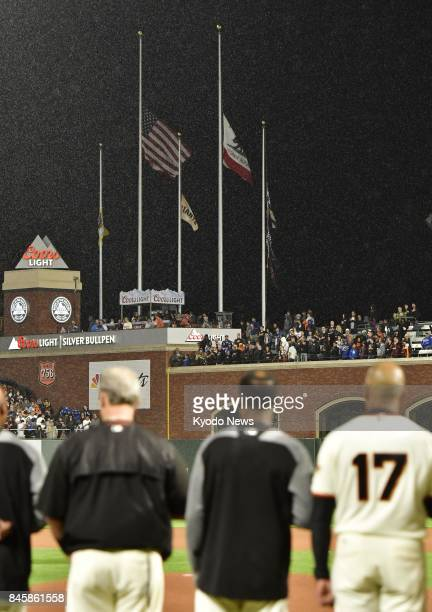 The US California and San Francisco Giants flags fly at halfmast at ATampT Park in San Francisco on Sept 11 the 16th anniversary of the terrorist...