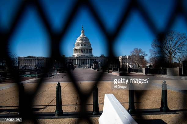 The U.S. Capitol, behind security fencing, on January 10, 2021 in Washington, DC. A pro-Trump mob stormed and desecrated the U.S. Capitol on January...