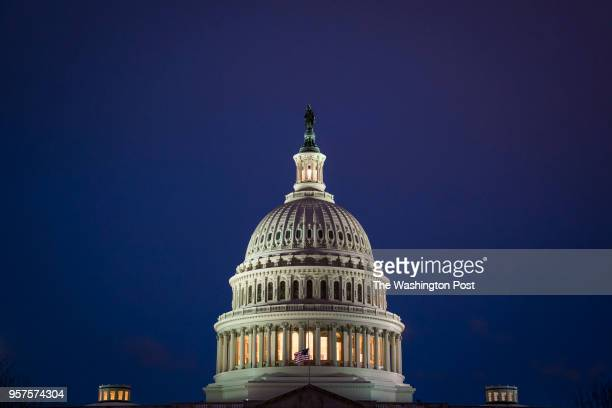 The US Capitol Building dome is seen as the sun sets after a Spring snow fall on Wednesday March 21 2018 in Washington DC
