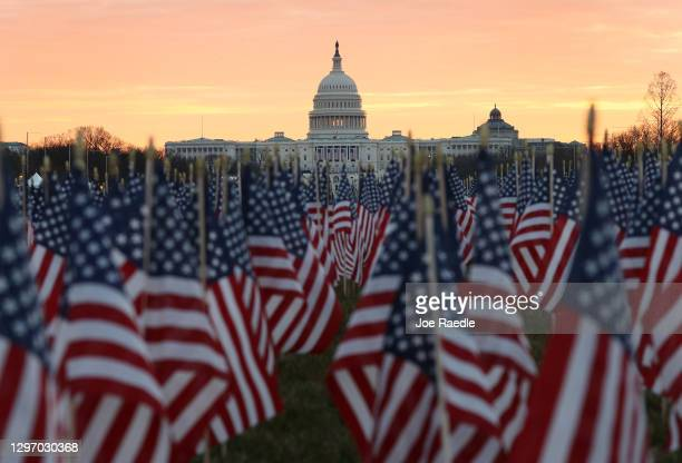 The U.S Capitol Building is prepared for the inaugural ceremonies for President-elect Joe Biden as American flags are placed in the ground on the...