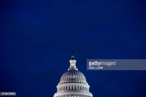TOPSHOT The US Capitol Building is seen at dusk in Washington DC February 6 as lawmakers work to avert a government shutdown later this week...