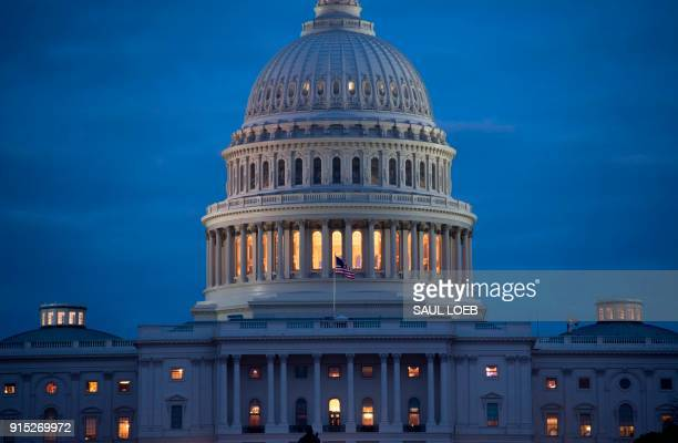 The US Capitol Building is seen at dusk in Washington DC February 6 as lawmakers work to avert a government shutdown later this week Congressional...