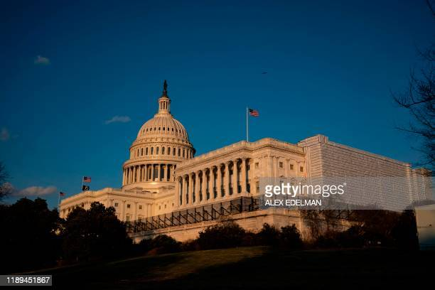 The US Capitol building is seen in Washington DC on December 18 2019 as the US House of Representatives debates two articles of impeachment against...