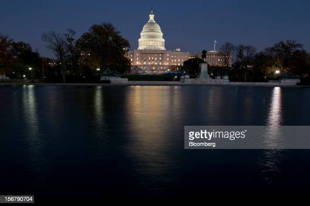 The US Capitol building stands at night in Washington DC US on Tuesday Nov 13 2012 President Barack Obama expressed confidence that he and Congress...
