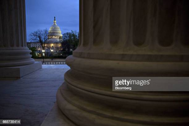 The US Capitol building stands past the US Supreme Court building in Washington DC US on Friday April 7 2017 Judge Neil Gorsuch is poised to win an...