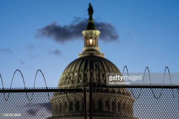 The U.S. Capitol Building, which saw boosted security, Thursday, after officials warned of an attack plot by extremists, two months after supporters...