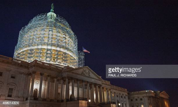The US Capitol dome is cocooned in scaffolding on October 28 2014 in Washington DC as it undergoes its first comprehensive repairs in more than half...