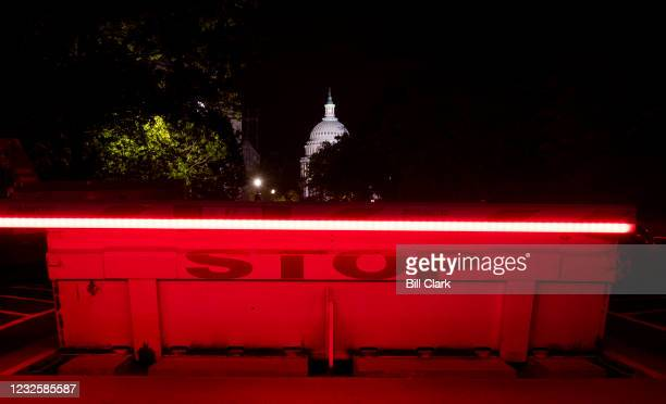 The U.S. Capitol dome is illuminated behind a vehicle security barricadeon the Senate side of the Capitol as President Joe Biden delivers his address...