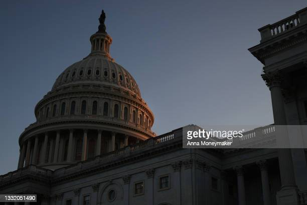 The U.S. Capitol Dome is illuminated by the sunset on August 02, 2021 in Washington, DC. The Senate has moved on to the amendments process this week...