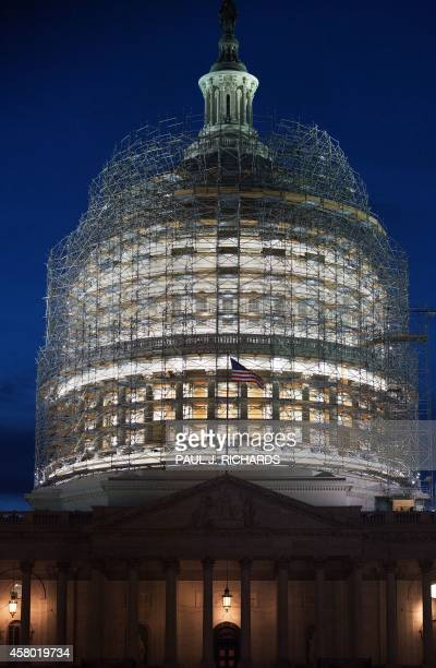 The US Capitol Dome is obscured in a maze of scaffolding October 28 2014 in Washington DC as it undergoes its first comprehensive repairs in more...