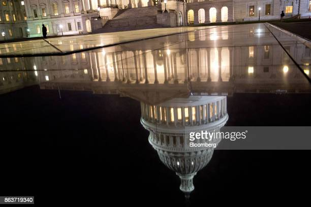 The US Capitol dome is reflected before sunrise in Washington DC US on Friday Oct 20 2017 President Donald Trump's top legislative priority took a...