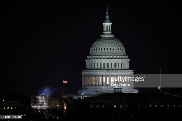 The U.S. Capitol dome stands after dark as a House Judiciary Committee markup hearing continues on the articles of impeachment against U.S. President...