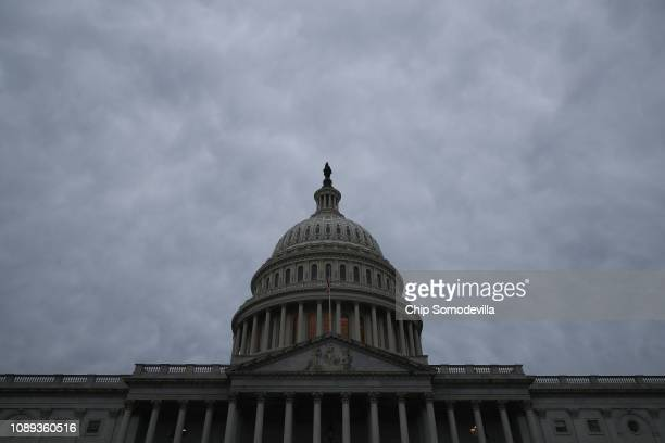 The US Capitol dome stands under a cloudy sky January 03 2019 in Washington DC The 116th Congress will convene Thursday with Democrats in control of...