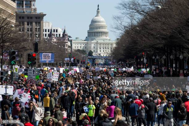 The US Capitol is pictured as demonstrators gather on Pennsylvania Avenue during the March for Our Lives rally March 24 2018 in Washington DC...