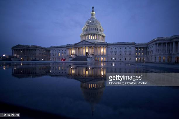 the u.s. capitol is reflected in a capitol visitor center fountain - capitol building washington dc stock pictures, royalty-free photos & images