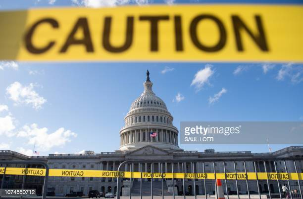 The US Capitol is seen ahead of a possible partial government shutdown in Washington DC December 21 2018 A threatened shutdown of the US government...