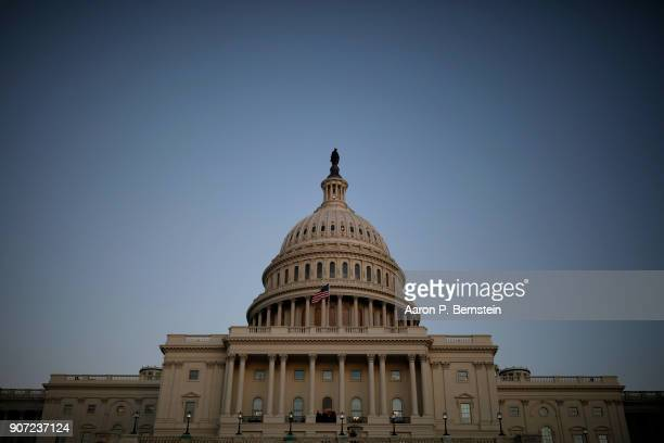 The US Capitol is seen as lawmakers work to avert a government shutdown January 19 2018 in Washington DC A continuing resolution to fund the...